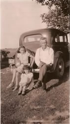 Bill Westphal, section crew manager, with daughters June and Gladys, circa 1940s